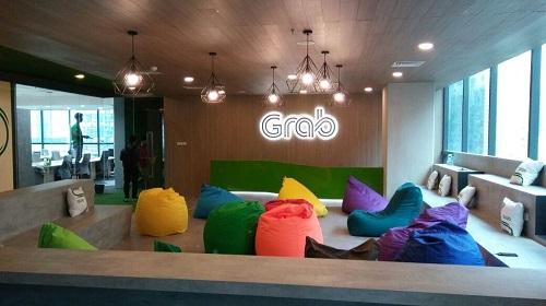 IPO Terikat Grab Pendapatan Bersih Naik